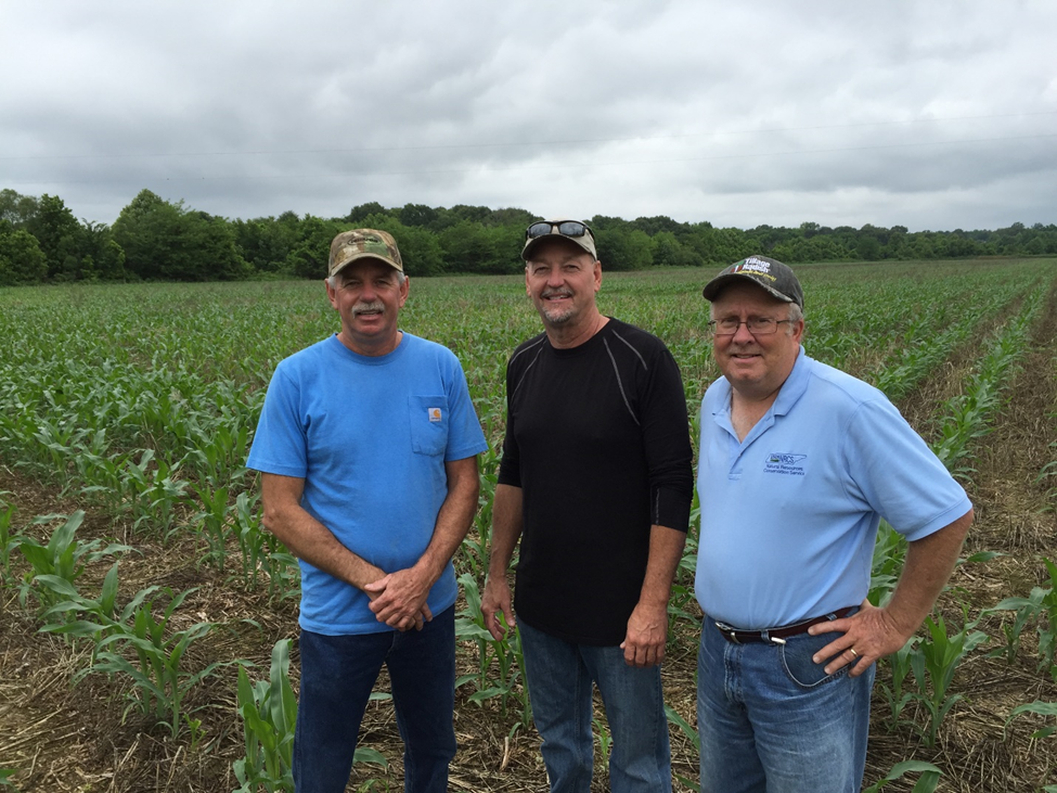 Tim and Tommy Colbert with Brad Denton, District Conservationist, NRCS